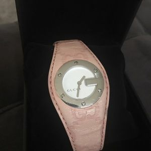 Gucci Authentic pink leather watch working good.